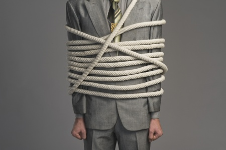 Mid section view of a businessman tied up with ropes Stock Photo - 10167900