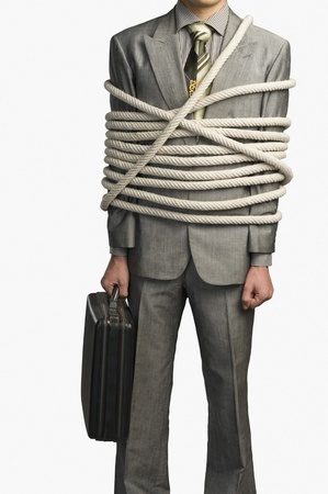 Mid section view of a businessman tied up with ropes Stock Photo - 10168005