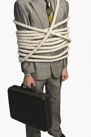 Mid section view of a businessman tied up with ropes Stock Photo - 10167944