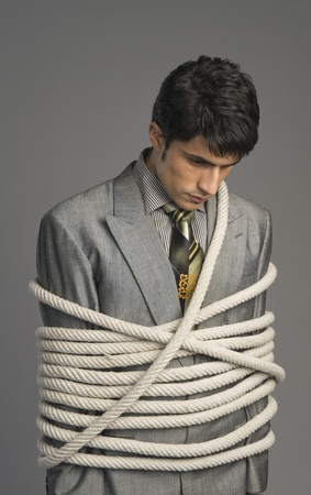 Close-up of a businessman tied up with ropes Stock Photo - 10167882