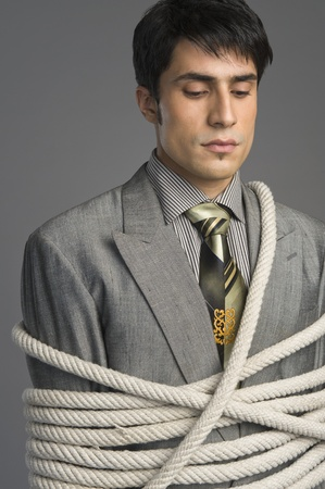 Close-up of a businessman tied up with ropes Stock Photo - 10167862