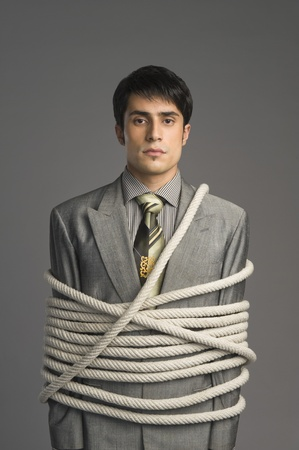 Portrait of a businessman tied up with ropes Stock Photo - 10167837