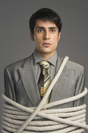 Close-up of a businessman tied up with ropes Stock Photo - 10167856