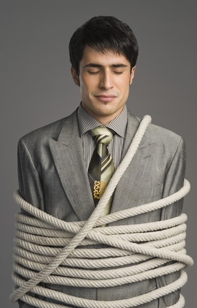 Close-up of a businessman tied up with ropes Stock Photo - 10167893