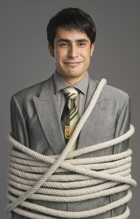 Portrait of a businessman tied up with ropes Stock Photo - 10167853