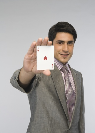 Businessman showing ace of hearts card Stock Photo - 10167816
