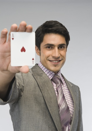 Businessman showing ace of hearts card Stock Photo - 10167888