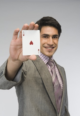 Businessman showing ace of hearts card Stock Photo - 10167844