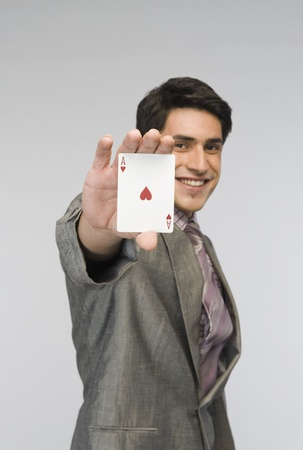 Businessman showing ace of hearts card Stock Photo - 10168548