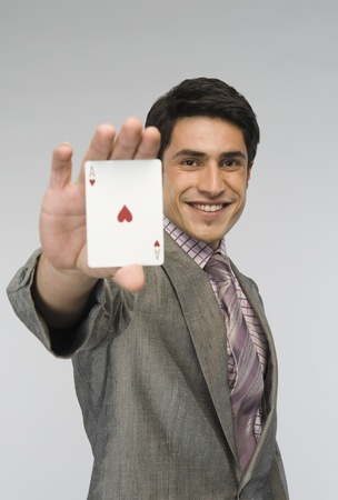 Businessman showing ace of hearts card Stock Photo - 10167817