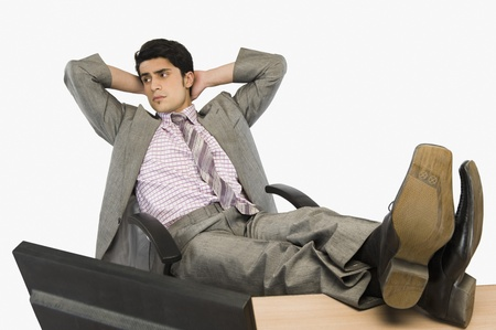 front desk: Businessman relaxing in an office LANG_EVOIMAGES