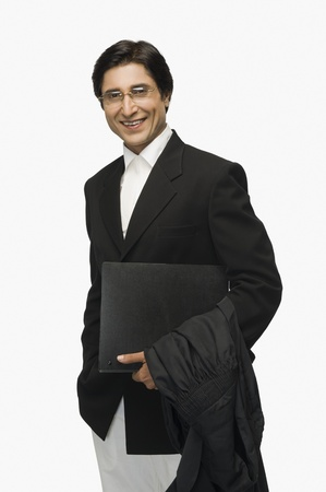 Portrait of a lawyer holding a file and smiling 版權商用圖片