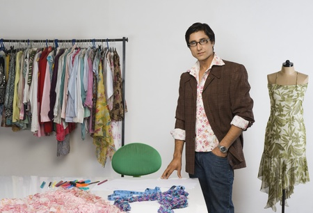 Portrait of a tailor standing in a clothing store LANG_EVOIMAGES