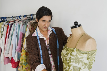 designer: Tailor working in a clothing store