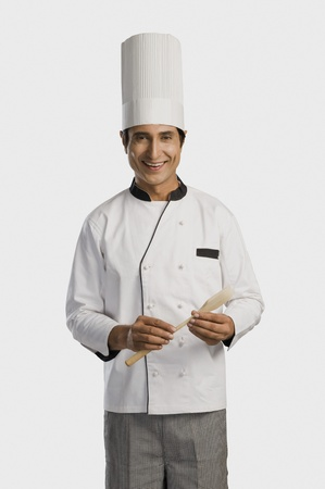 Portrait of a chef holding a wooden spoon Stock Photo - 10167073