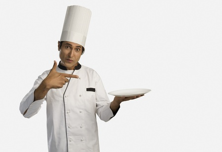 chefs whites: Portrait of a chef holding a plate