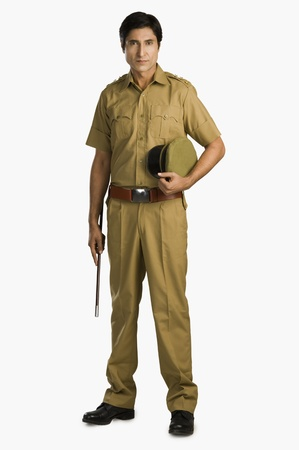 nightstick: Portrait of a police officer holding a nightstick