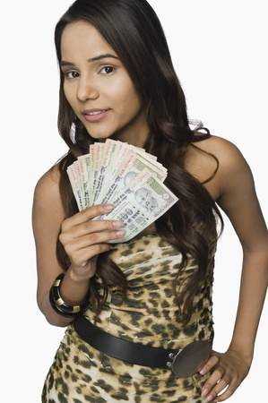 Woman holding currency notes Stock Photo - 10167658