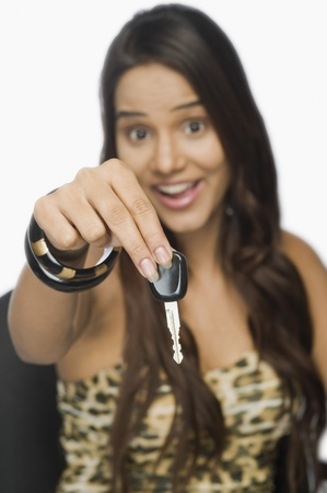 Portrait of a woman showing a car key Stock Photo - 10167119