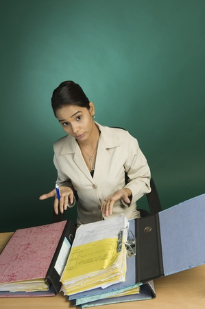Businesswoman with files in an office Stock Photo - 10168075