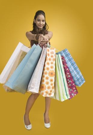 Woman showing shopping bags Stock Photo - 10167426