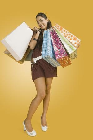 Woman carrying shopping bags Stock Photo - 10168180