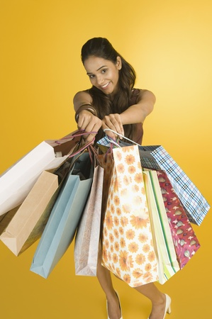 Woman showing shopping bags and smiling Stock Photo - 10168038
