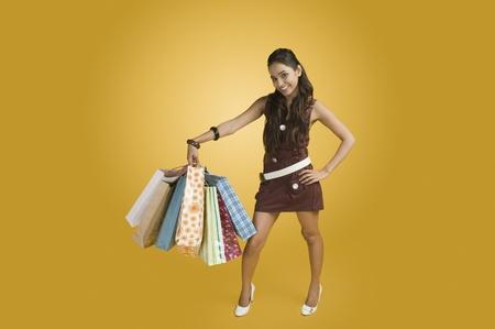 Woman carrying shopping bags Stock Photo - 10167210