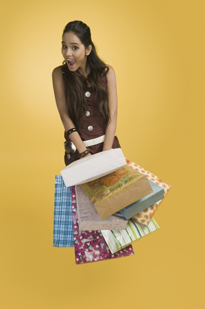 Woman holding shopping bags Stock Photo - 10168403