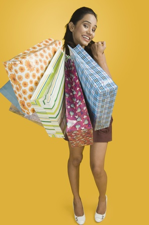Woman showing shopping bags and smiling Stock Photo - 10168271