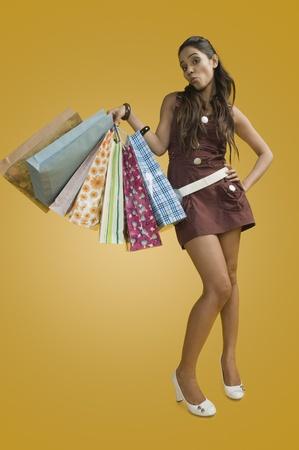Woman carrying shopping bags Stock Photo - 10168353