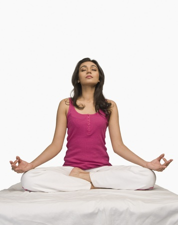 Woman meditating Stock Photo