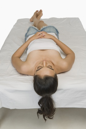 High angle view of a woman sleeping in the bed Stock Photo - 10167172