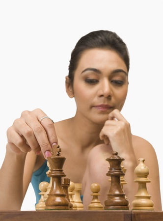 Woman playing chess Stock Photo - 10168782