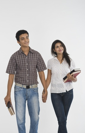 path to romance: College students walking with holding hands LANG_EVOIMAGES