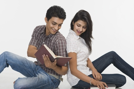 book: College students reading a book