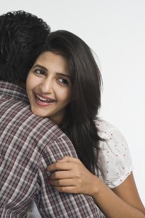 Woman embracing a man Stock Photo - 10167769