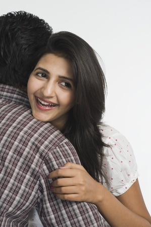 Woman embracing a man Stock Photo - 10167769