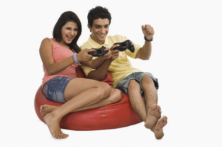 Couple playing a video game on a bean bag