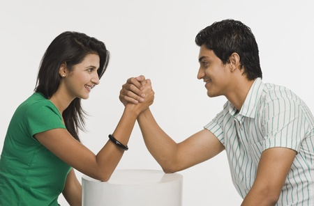 Couple arm wrestling Stock Photo - 10167445