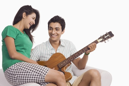 love image: Man playing a guitar beside a woman