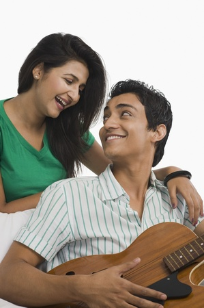 path to romance: Man playing a guitar beside a woman