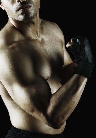 only the biceps: Close-up of a muscular man showing his biceps