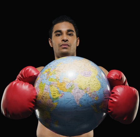 Portrait of a male boxer holding a globe Stock Photo - 10167018