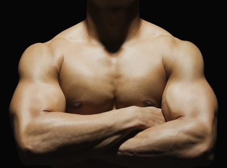 bare chest: Close-up of a muscular man showing his muscles LANG_EVOIMAGES