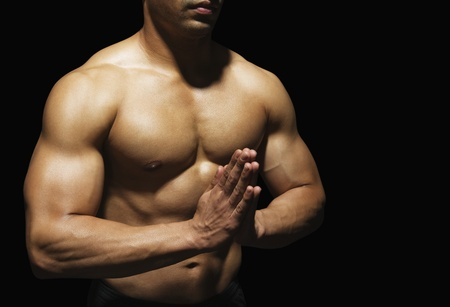 only the biceps: Close-up of a muscular man meditating