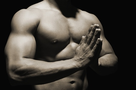body conscious: Mid section view of a muscular man meditating