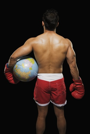 Rear view of a male boxer holding a globe Stock Photo - 10166988
