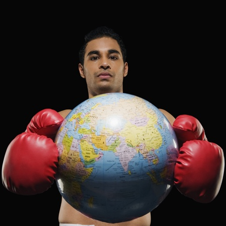Portrait of a male boxer holding a globe Stock Photo - 10168722
