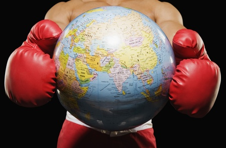 Mid section view of a boxer holding globe Stock Photo - 10167993